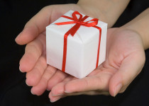 Image of hands offering a gift