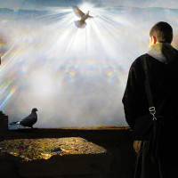 Image of a man and dove